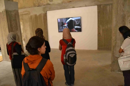 """<a class=""""fancybox"""" rel=""""gallery-images"""" href=""""http://passageways.clustermappinginitiative.org/sites/default/files/styles/largest/public/8._dsc_0902.jpg?itok=OuSMvG9N"""" title=""""Hassan Khan Exhibition opening"""">Enlarge</a><br >Hassan Khan Exhibition opening"""