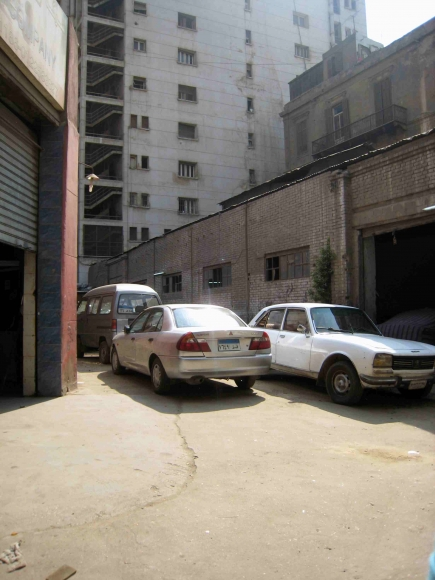 """<a class=""""fancybox"""" rel=""""gallery-"""" href=""""http://passageways.clustermappinginitiative.org/sites/default/files/styles/largest/public/d19_01.jpg?itok=EZrkrXDu"""" title=""""Cairo Motor Company engulfes the passageway"""">Enlarge</a><br >2015, Oct 18, 04:10am<br>Cairo Motor Company engulfes the passageway"""